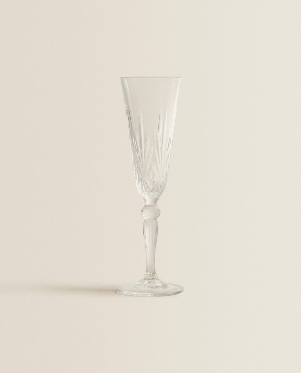 CRYSTALLINE CHAMPAGNE FLUTE WITH RAISED DESIGN