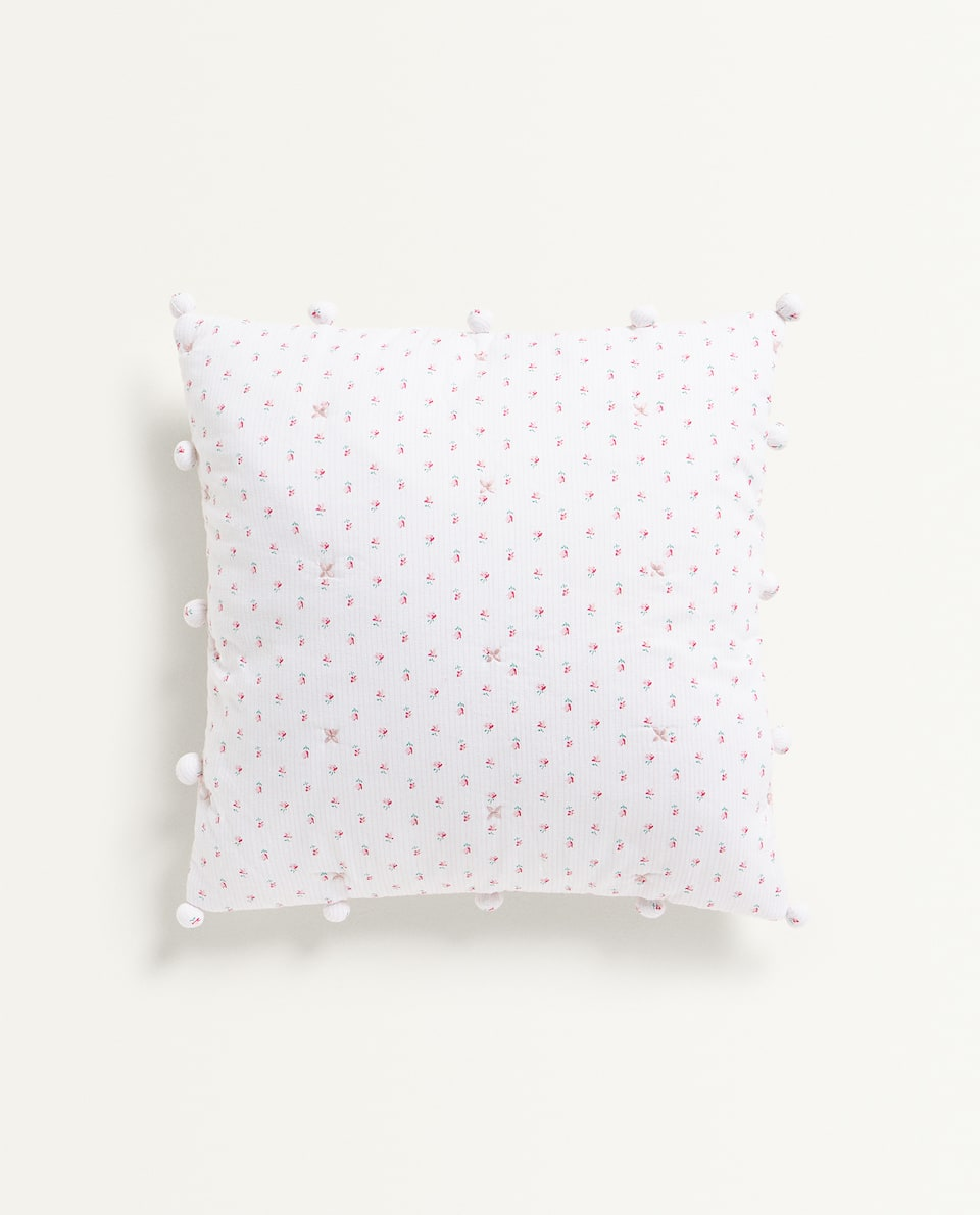 FLORAL PRINT CUSHION COVER WITH POMPOMS