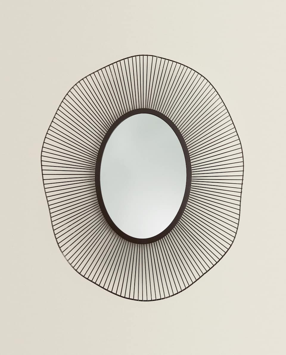 MIRROR WITH IRREGULAR METAL FRAME