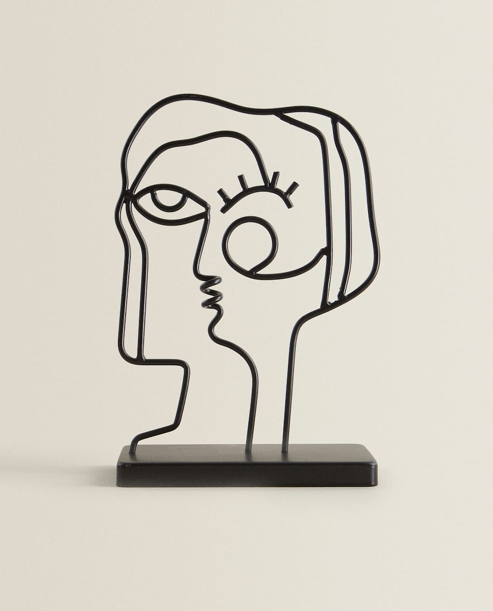DECORATIVE FACE FIGURE