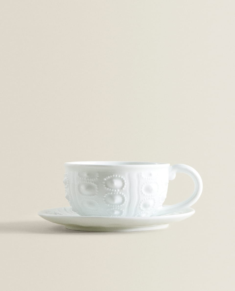 PORCELAIN TEACUP WITH RAISED PATTERN