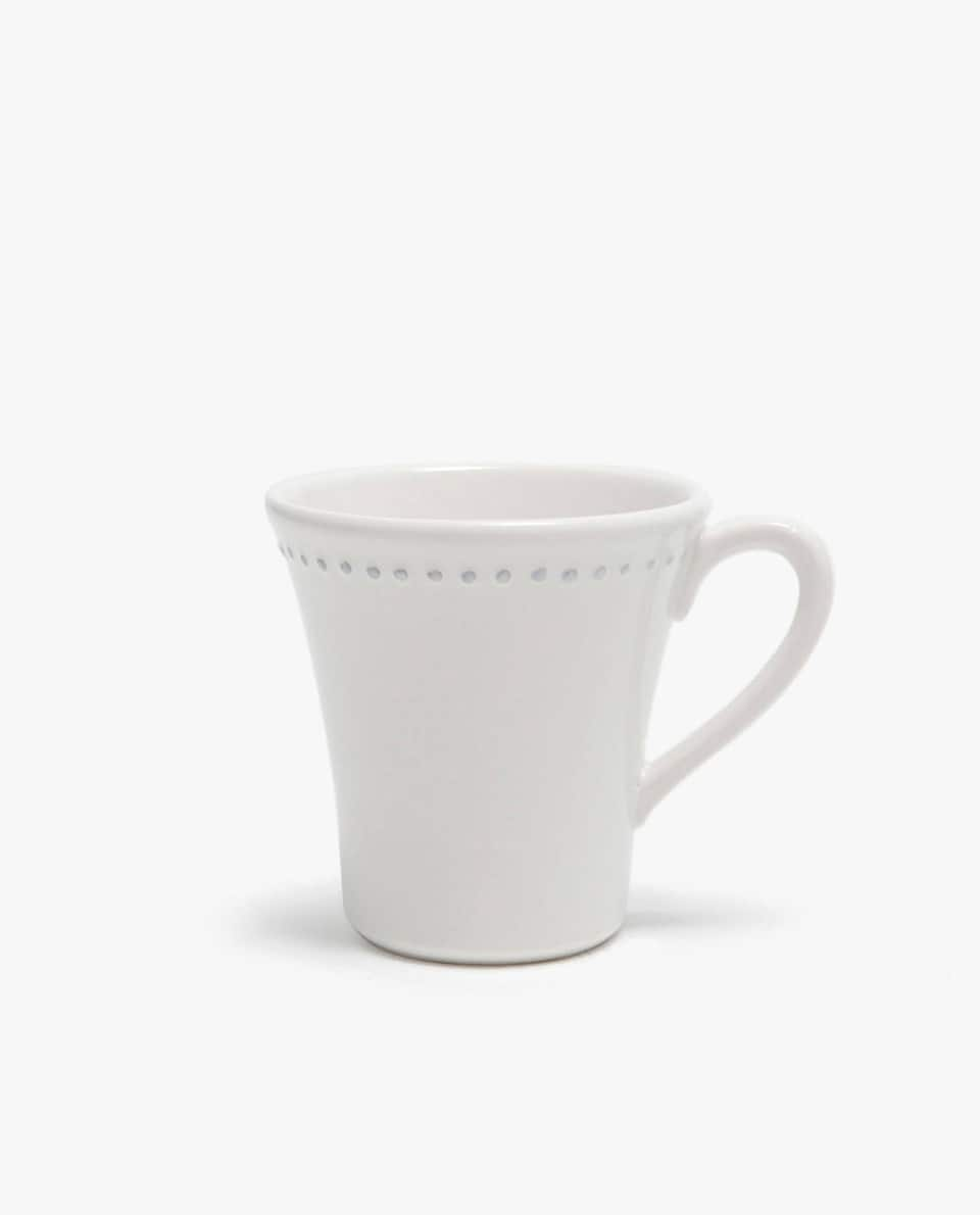 EARTHENWARE MUG WITH RAISED-DESIGN EDGE