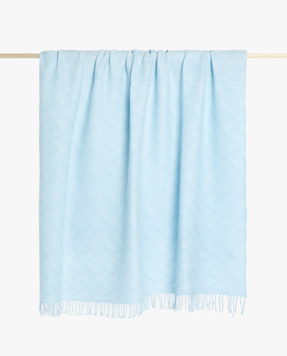 PLEATED BLANKET WITH FRINGING