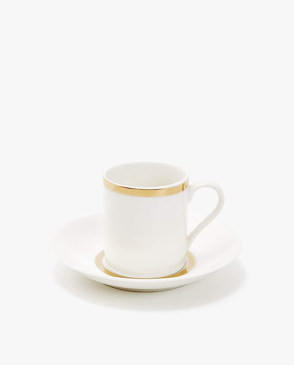 PORCELAIN COFFEE CUP AND SAUCER WITH GOLD RIM