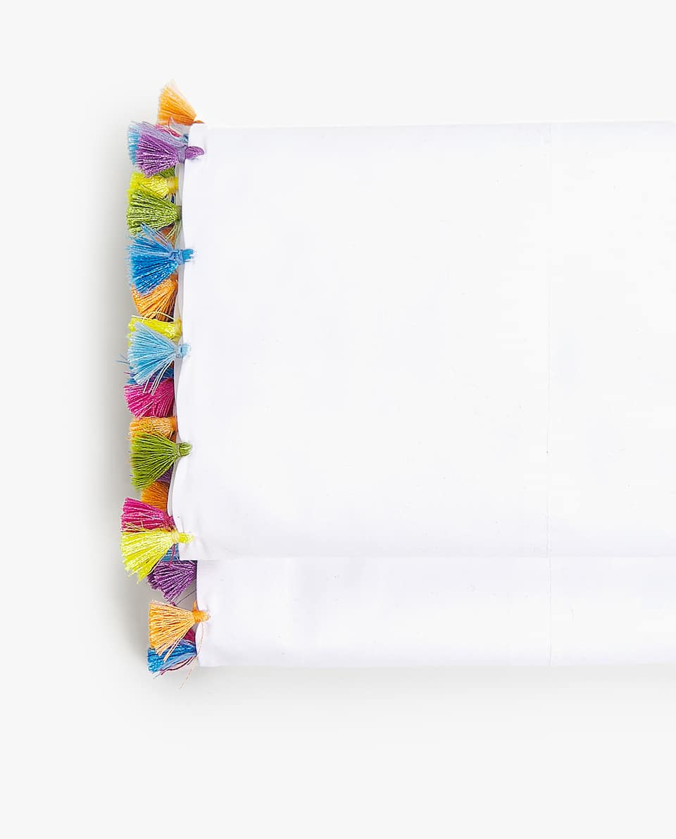 FLAT SHEET WITH MULTICOLOURED POMPOMS