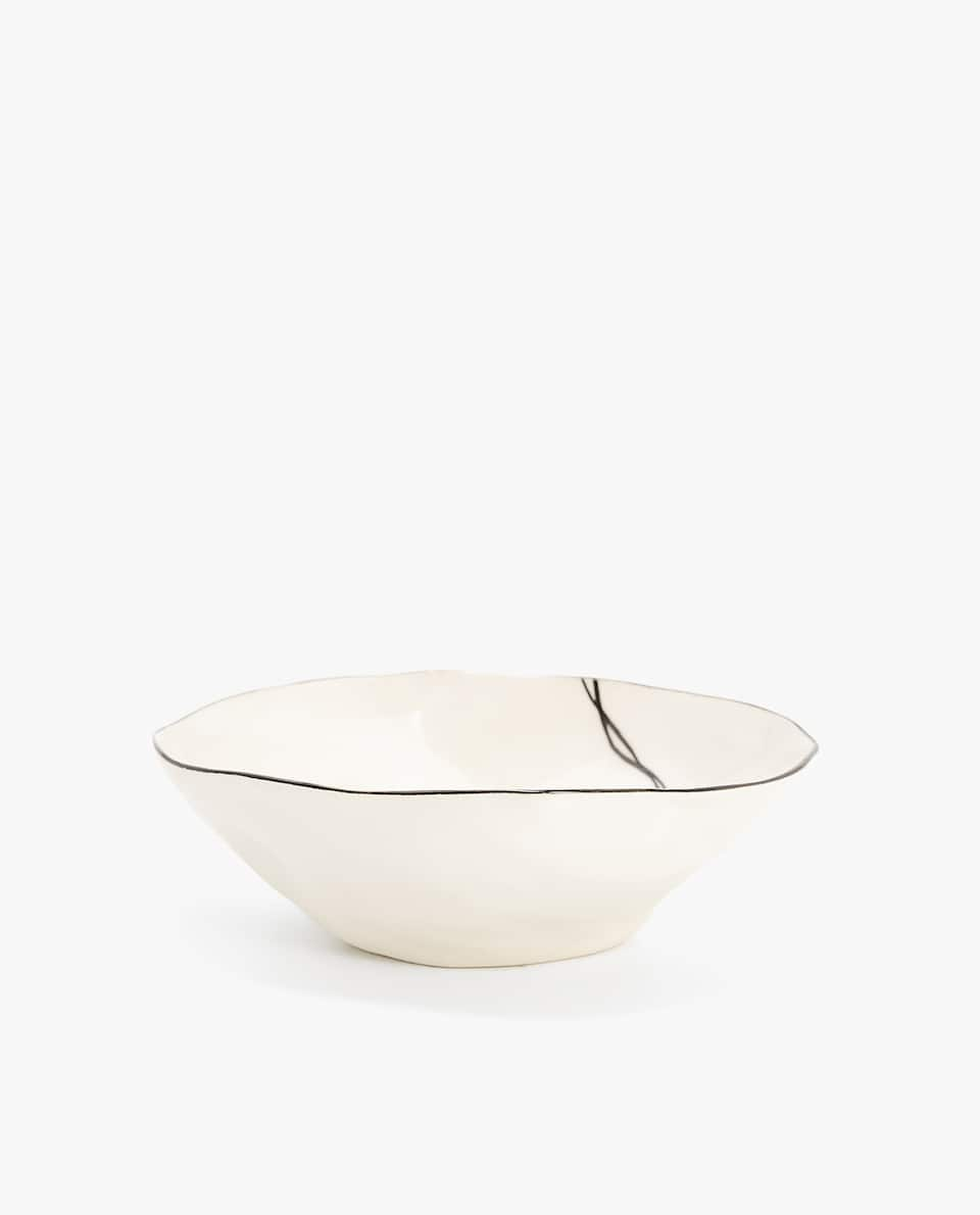 ULTRA LIGHTWEIGHT STONEWARE BOWL WITH AN IRREGULAR SHAPE