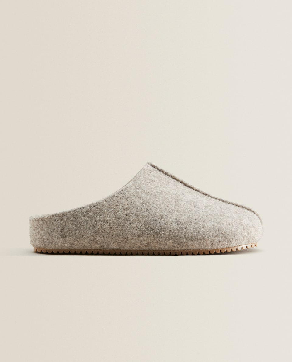 Lined felt mule slippers.