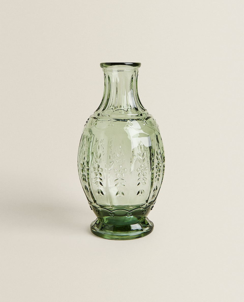 GLASS BOTTLE WITH FLORAL RELIEF