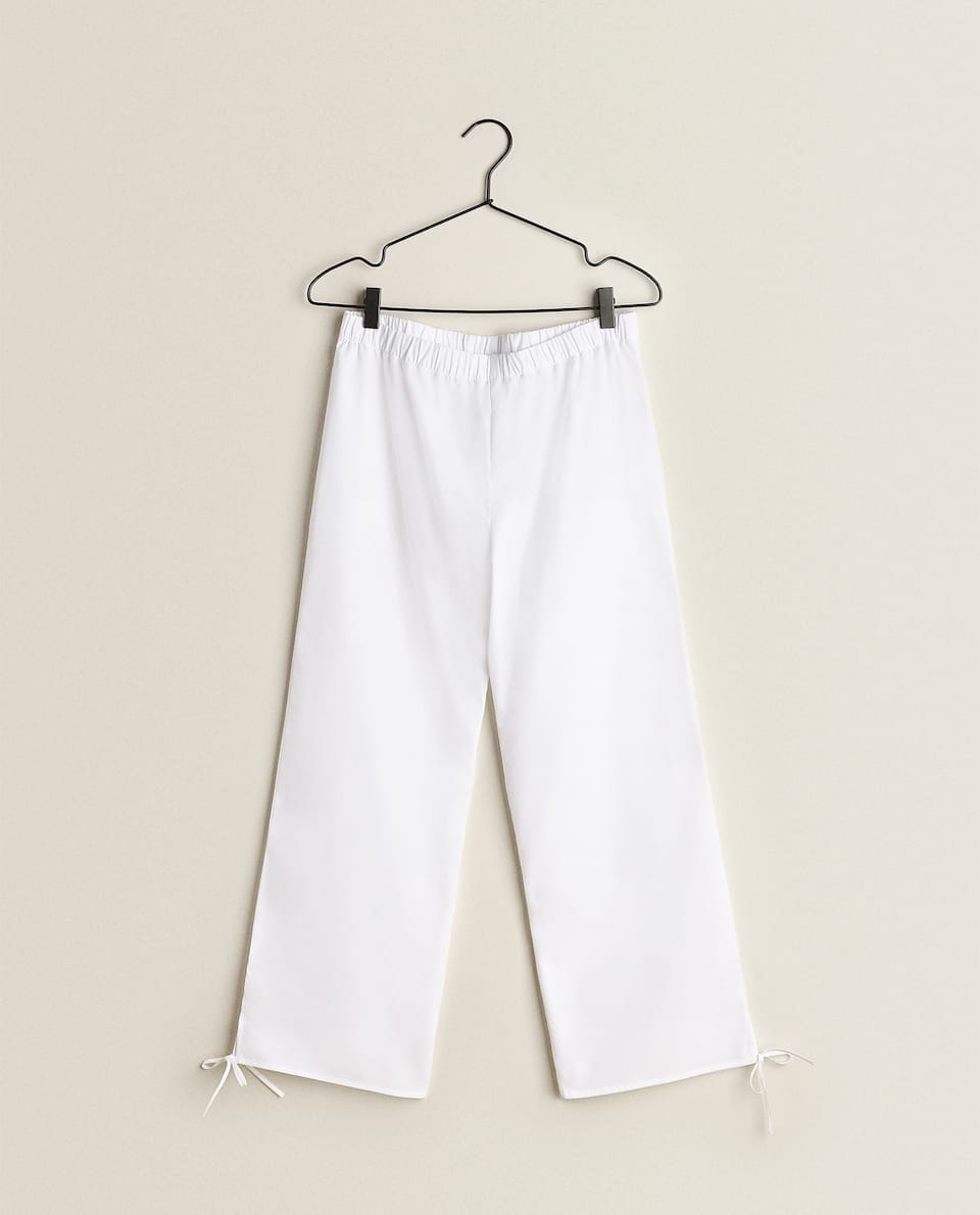 COTTON TROUSERS WITH TRIMS