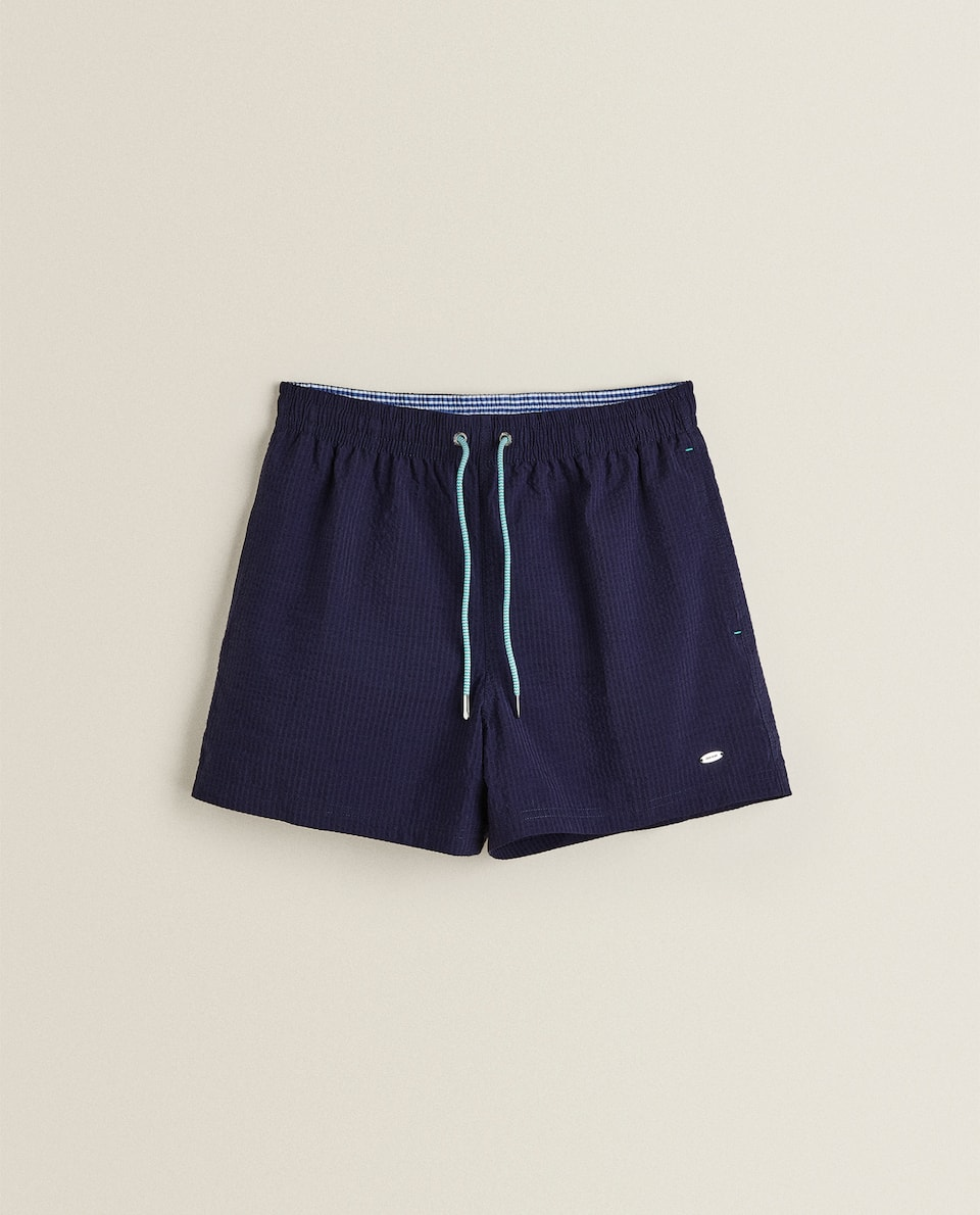PLAIN SEERSUCKER SWIMMING TRUNKS