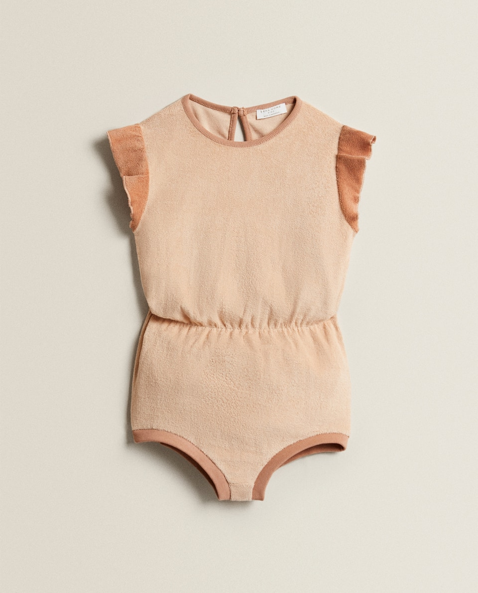 BODYSUIT WITH RUFFLE TRIMS