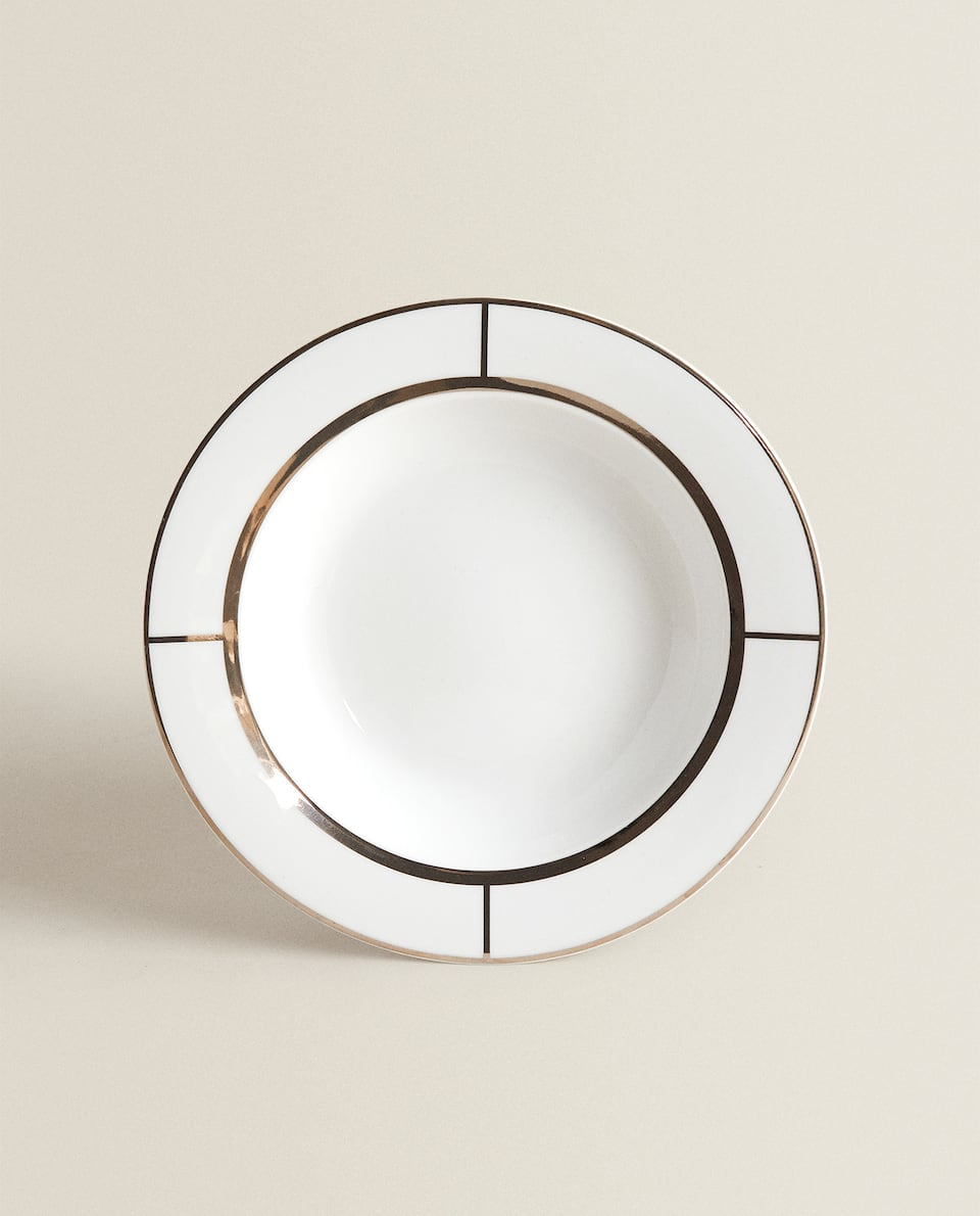 SILVER-RIMMED SOUP PLATE