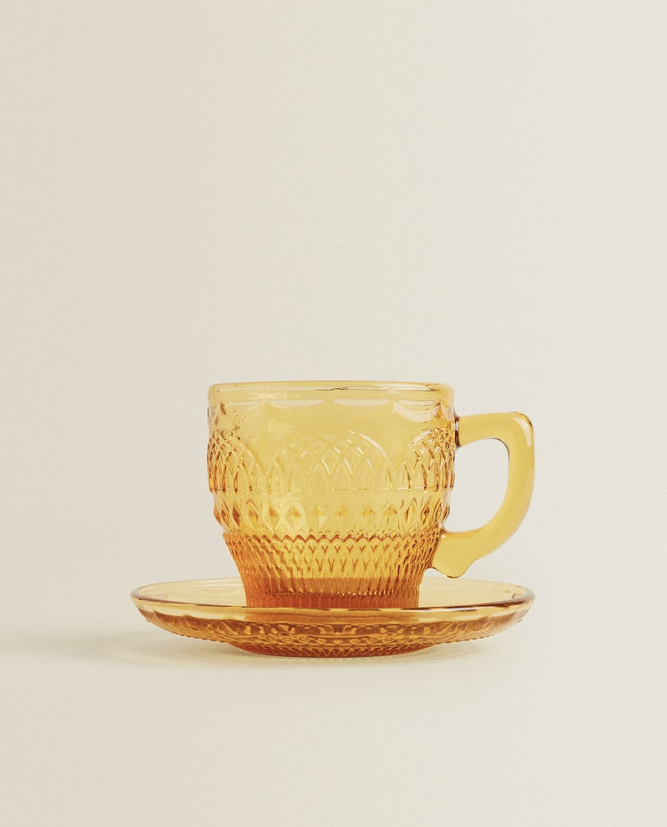 RAISED-DESIGN GLASS TEACUP AND SAUCER