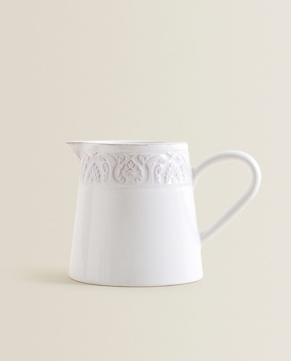 RAISED-DESIGN EARTHENWARE MILK JUG