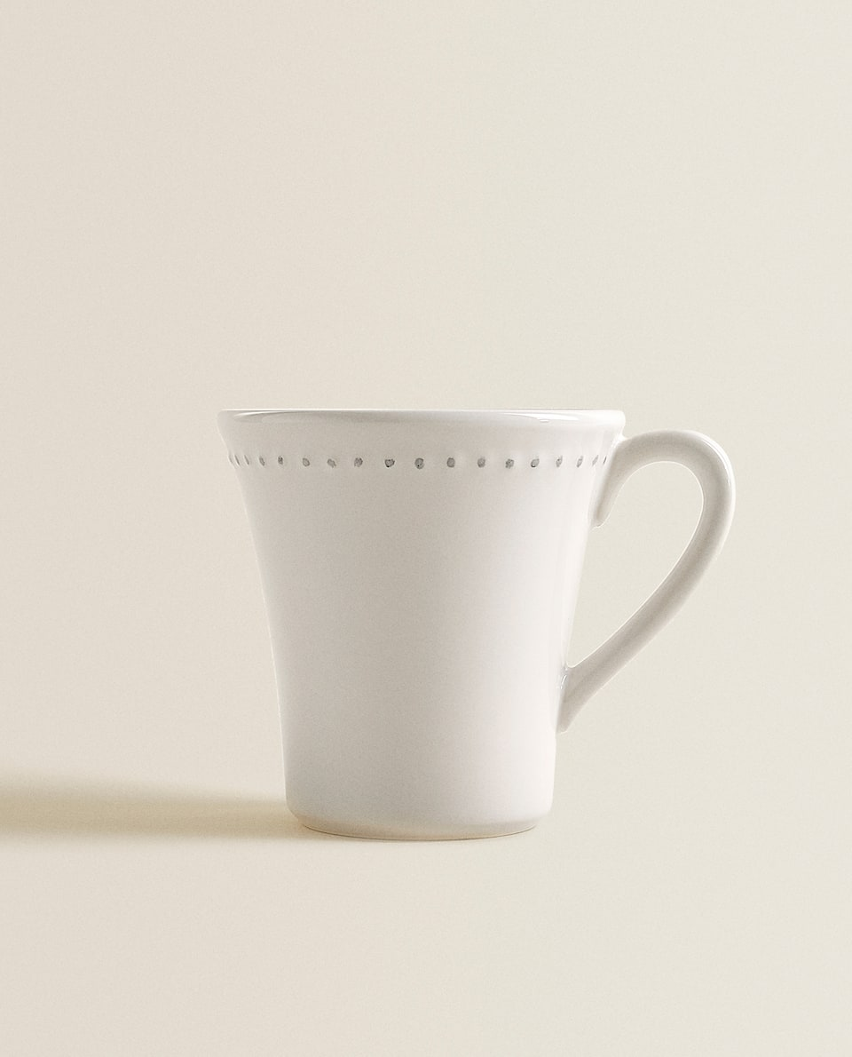 MUG WITH RAISED-DESIGN EDGE
