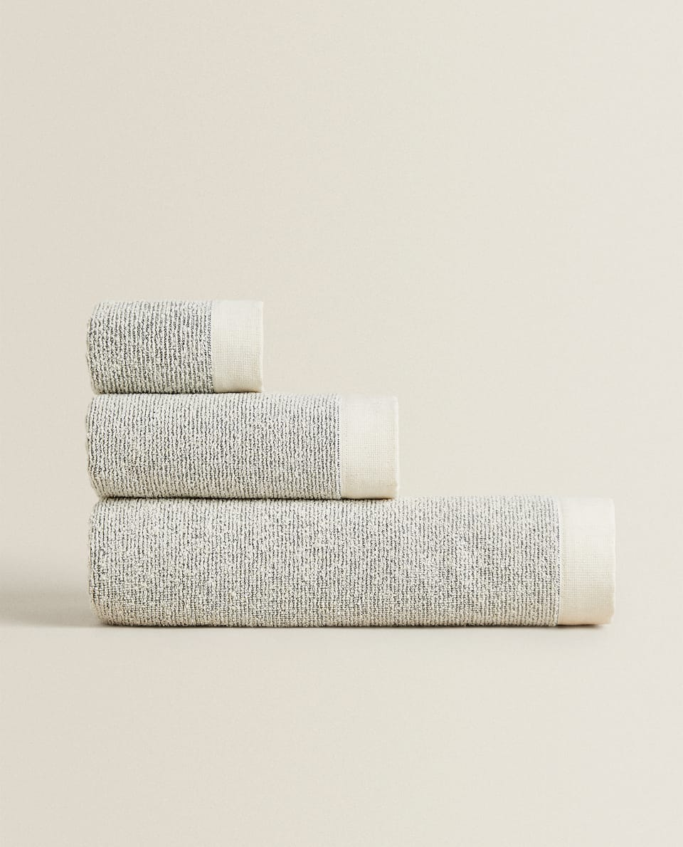 TEXTURED TOWEL WITH BORDER
