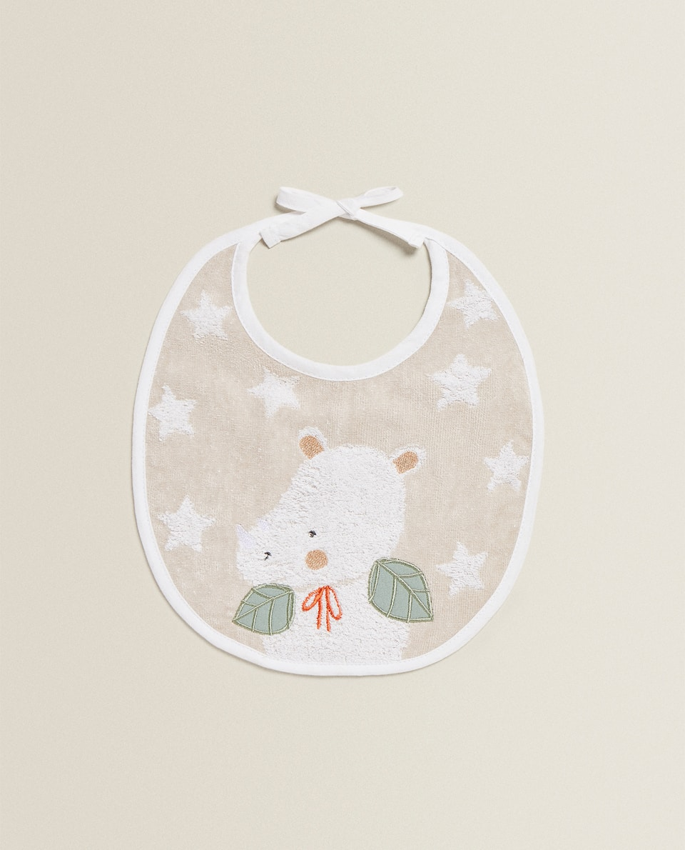BIB WITH EMBROIDERED RHINOCEROS
