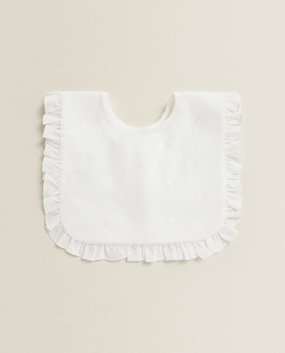 SQUARE BIB WITH RUFFLE TRIM