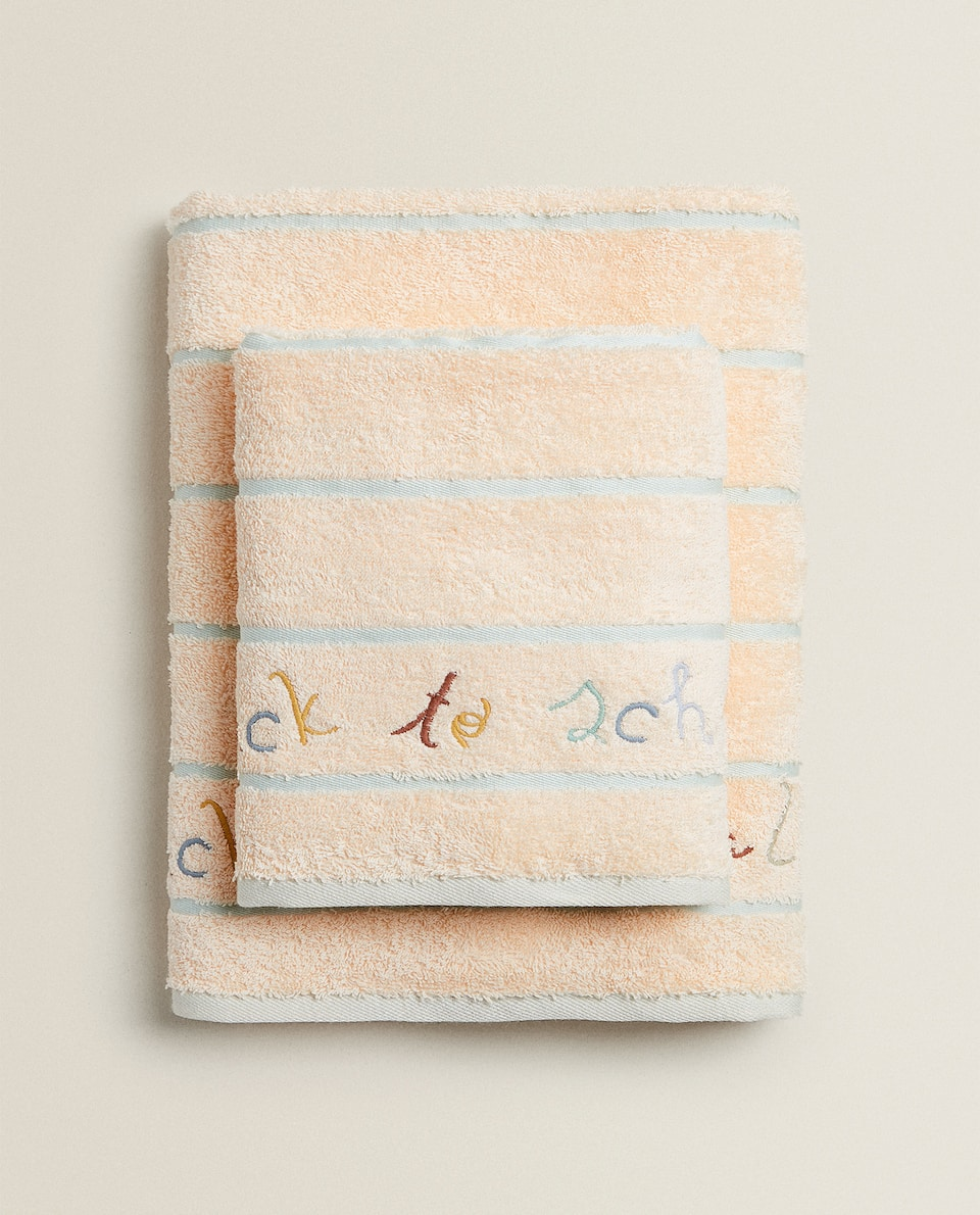 TOWEL WITH NOTEBOOK DESIGN