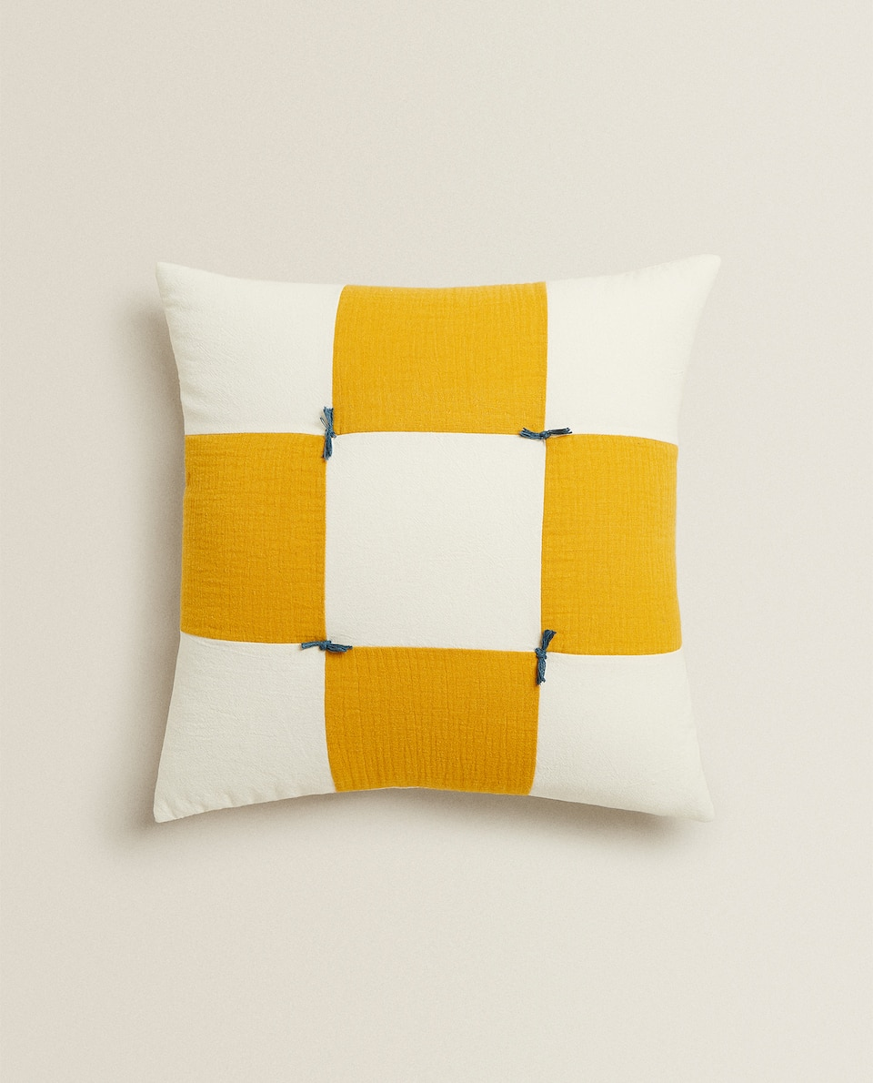 REVERSIBLE CHECK AND STAR PRINT CUSHION COVER