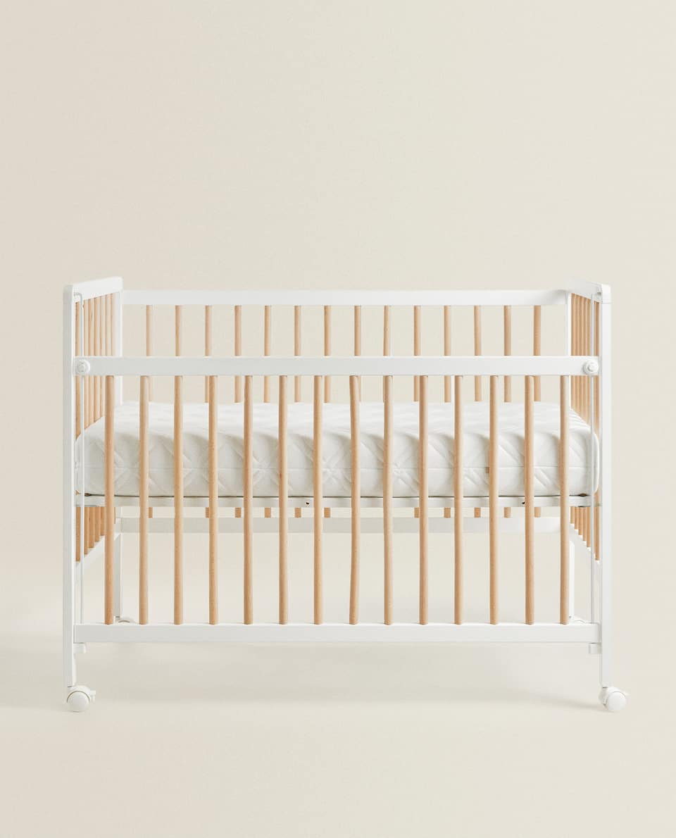 WHITE AND NATURAL WOODEN COT
