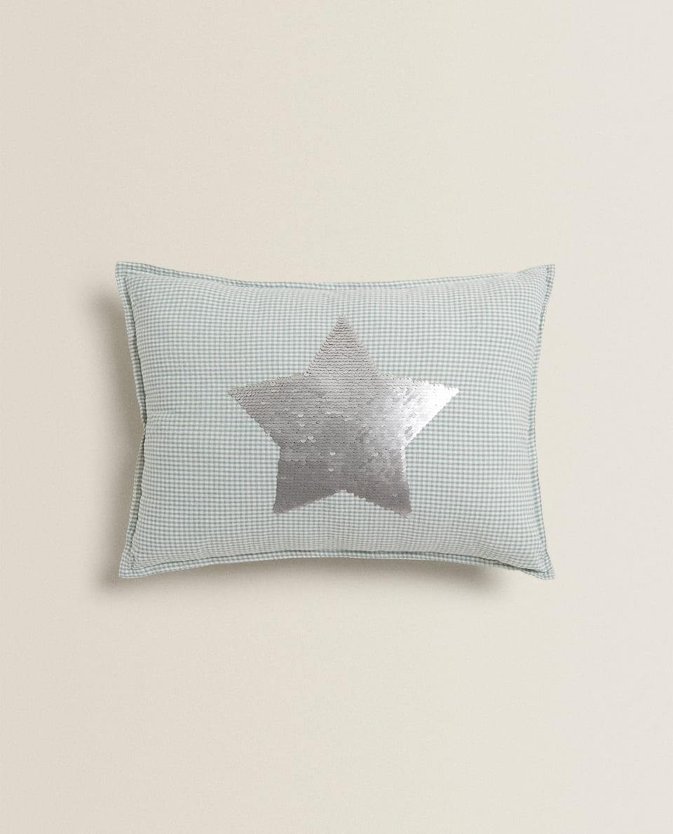 SEQUINNED STAR CUSHION