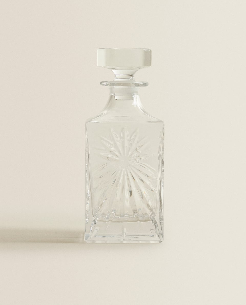 CRYSTALLINE BOTTLE WITH RAISED DESIGN