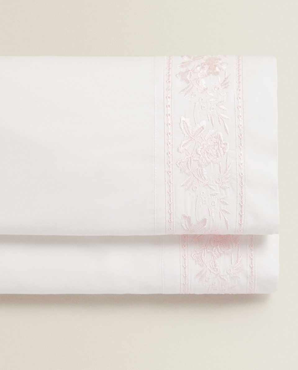 FLAT SHEET WITH EMBROIDERED FRETWORK AND ROSES