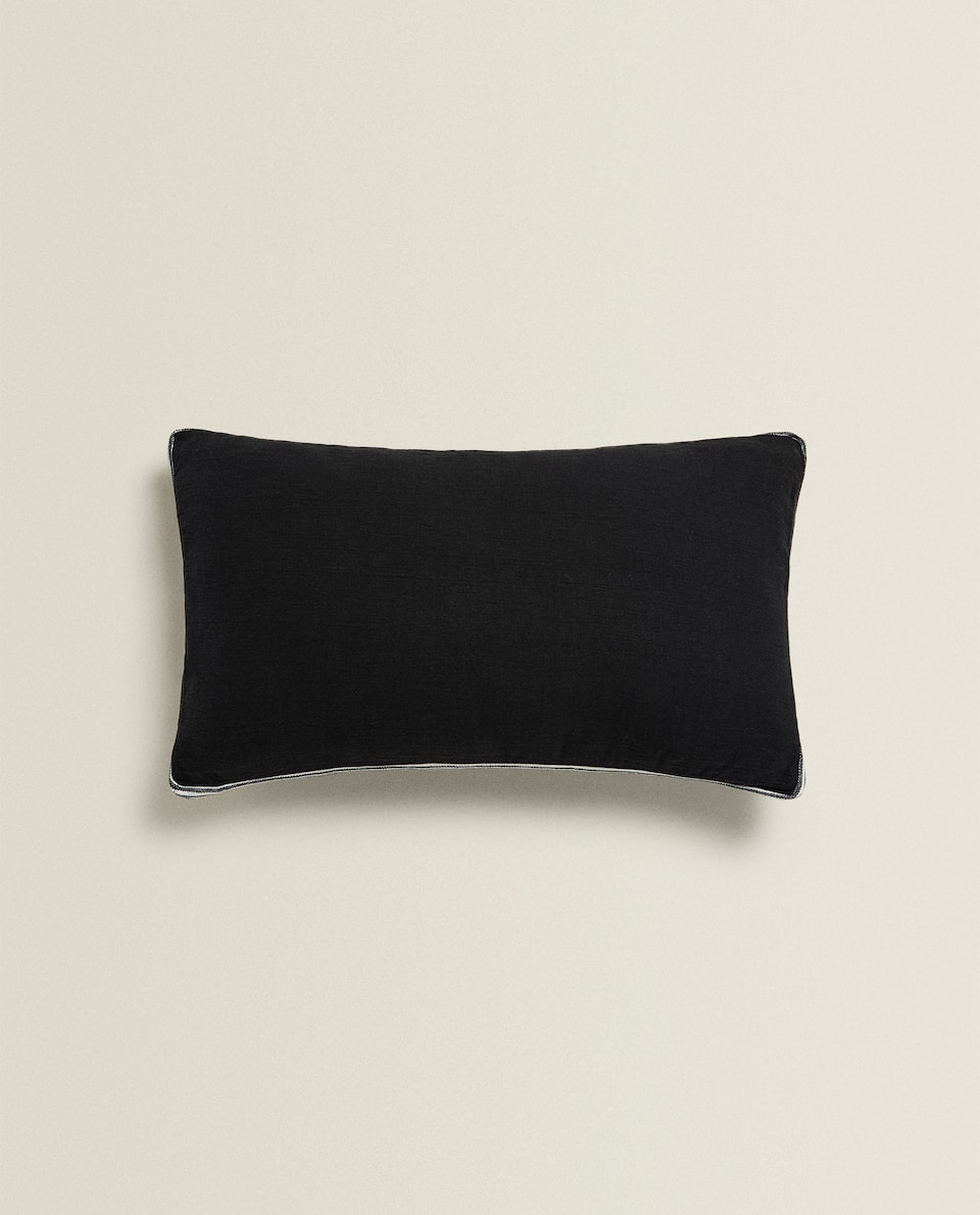 BLACK CUSHION WITH TRIM