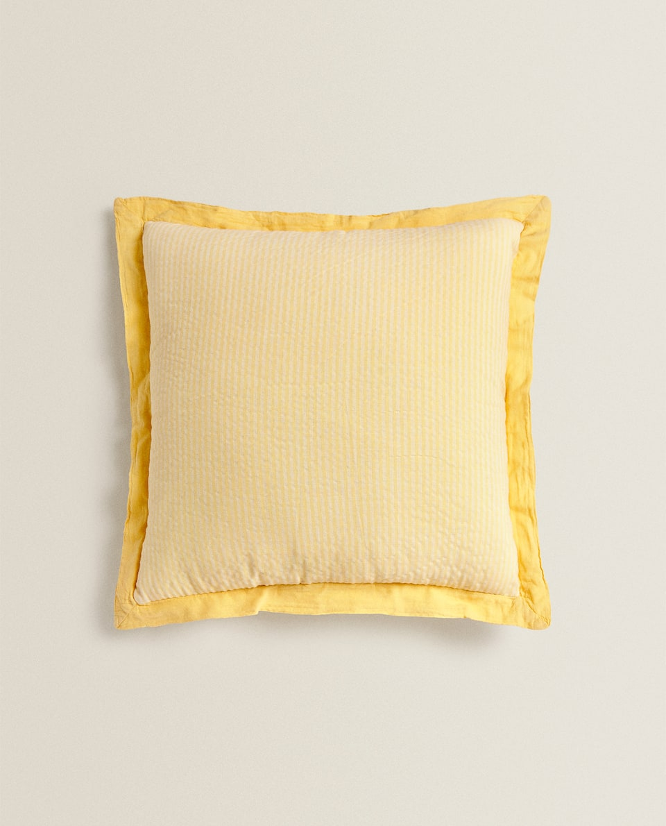 REVERSIBLE YELLOW COTTON AND LINEN CUSHION COVER.