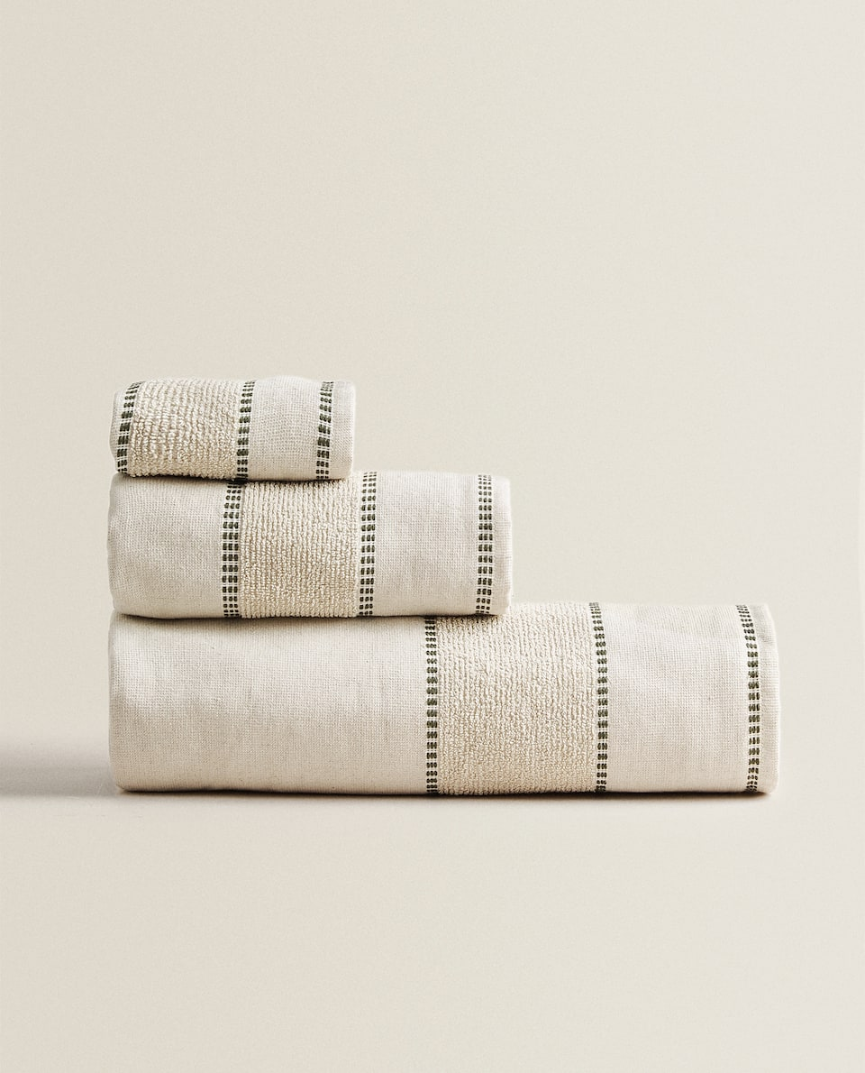 TOWEL WITH TERRYCLOTH BORDER