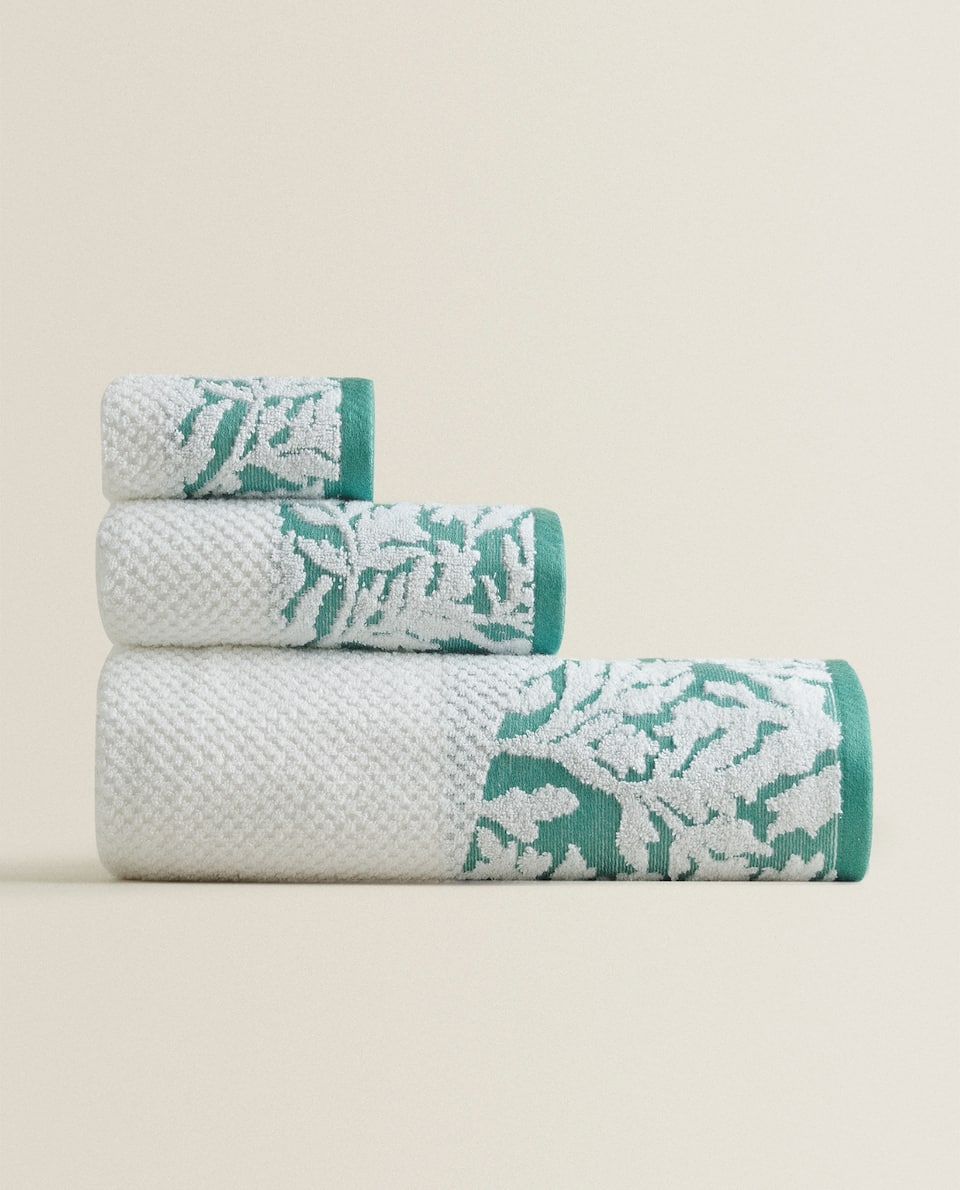 TOWEL WITH FLORAL BORDER