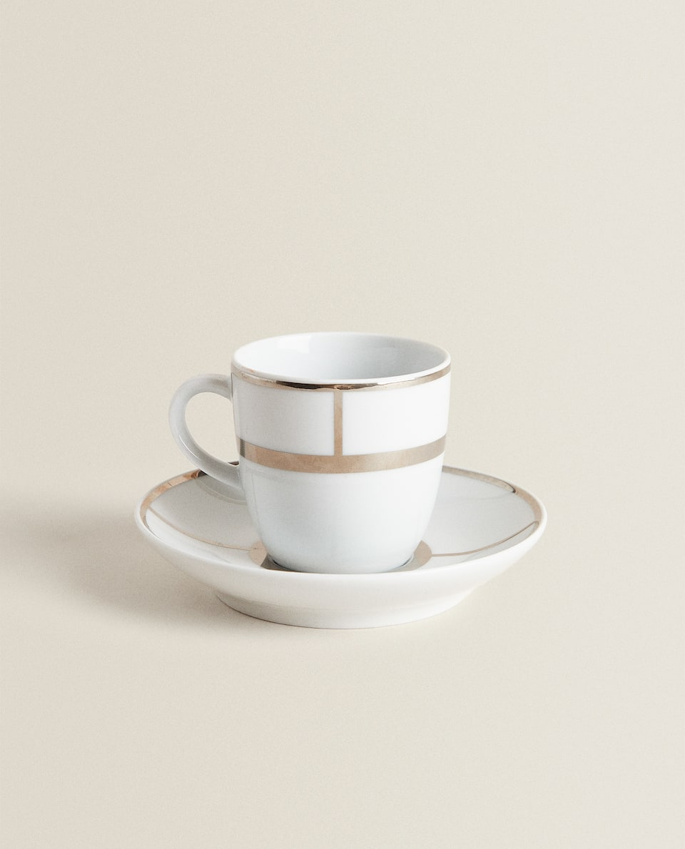 GOLD-RIMMED COFFEE CUP