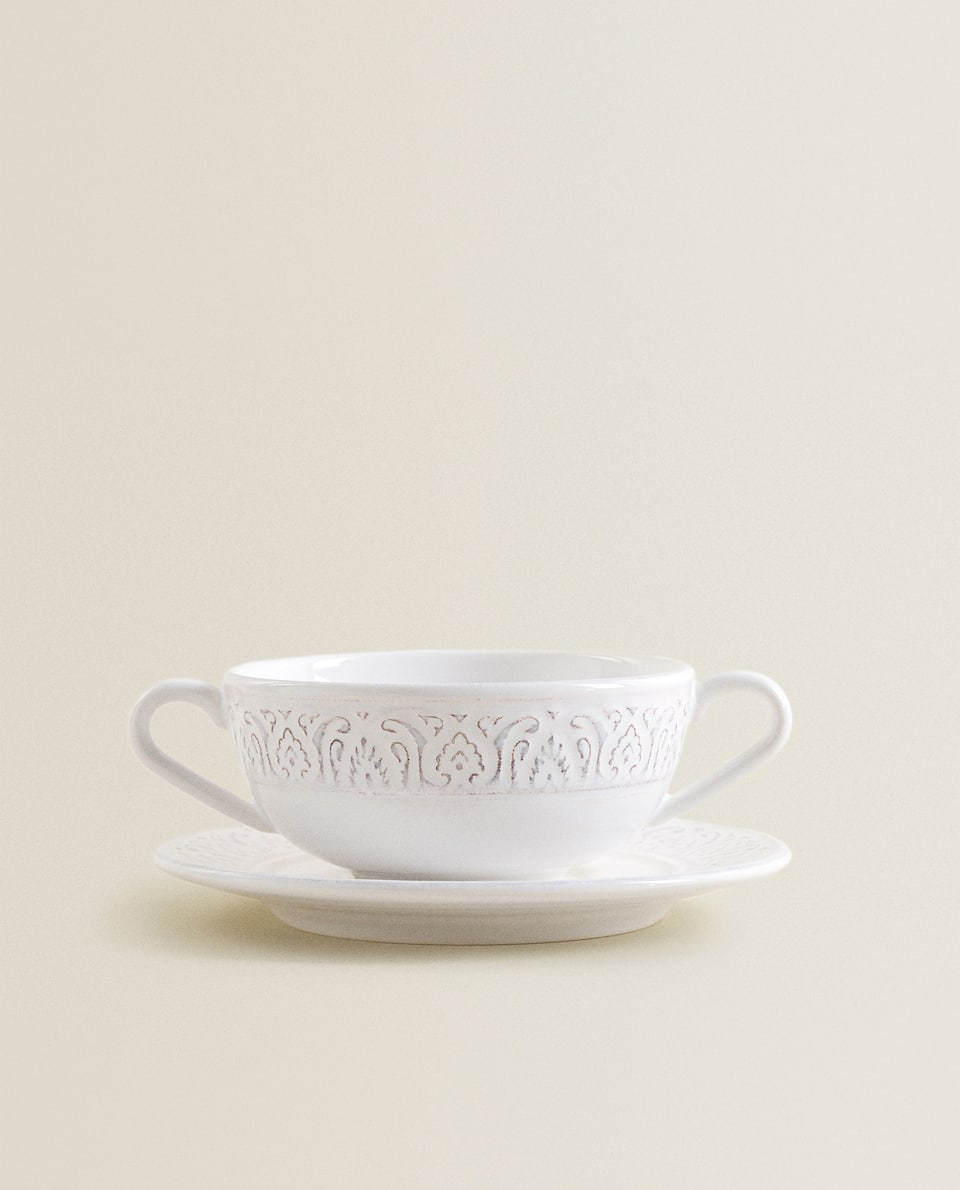 RAISED-DESIGN EARTHENWARE CONSOMMÉ BOWL AND SAUCER
