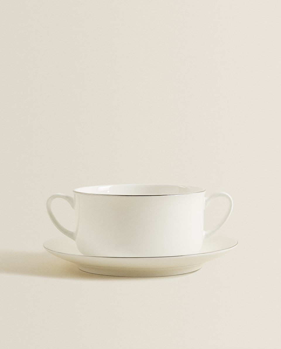 PORCELAIN SOUP BOWL AND SAUCER WITH SILVER RIM