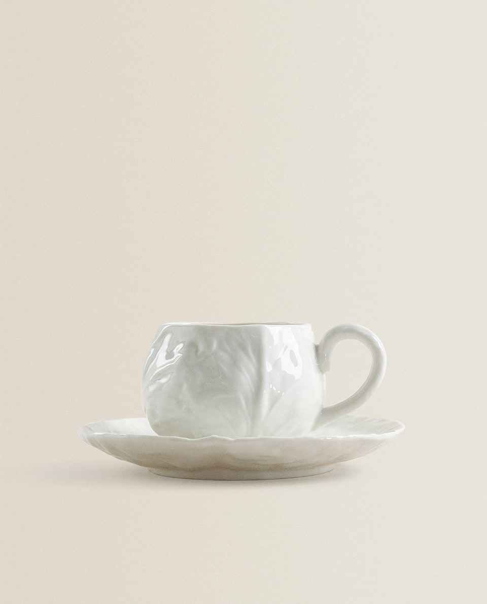 CUP AND SAUCER WITH PLANT TEXTURE