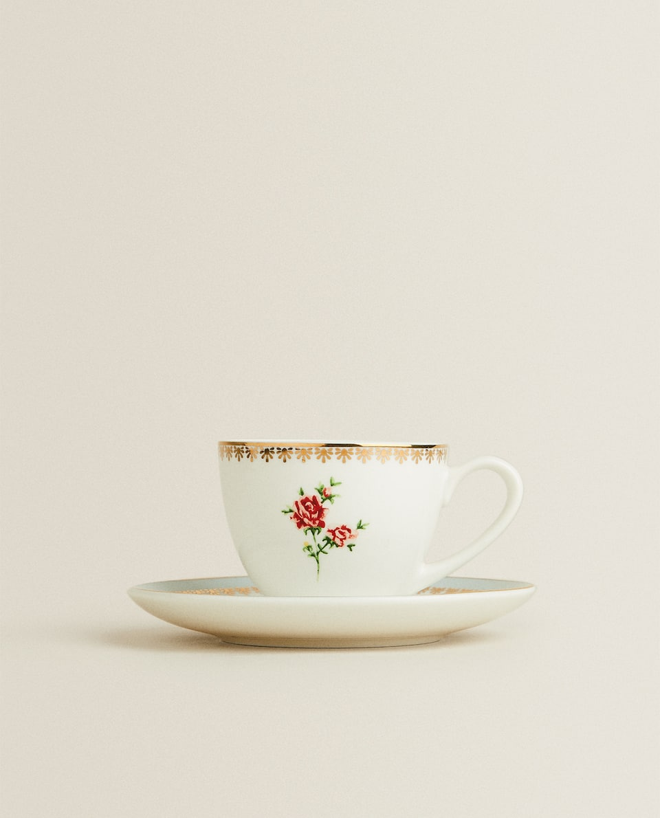 FLORAL CUP AND SAUCER WITH GOLD RIM