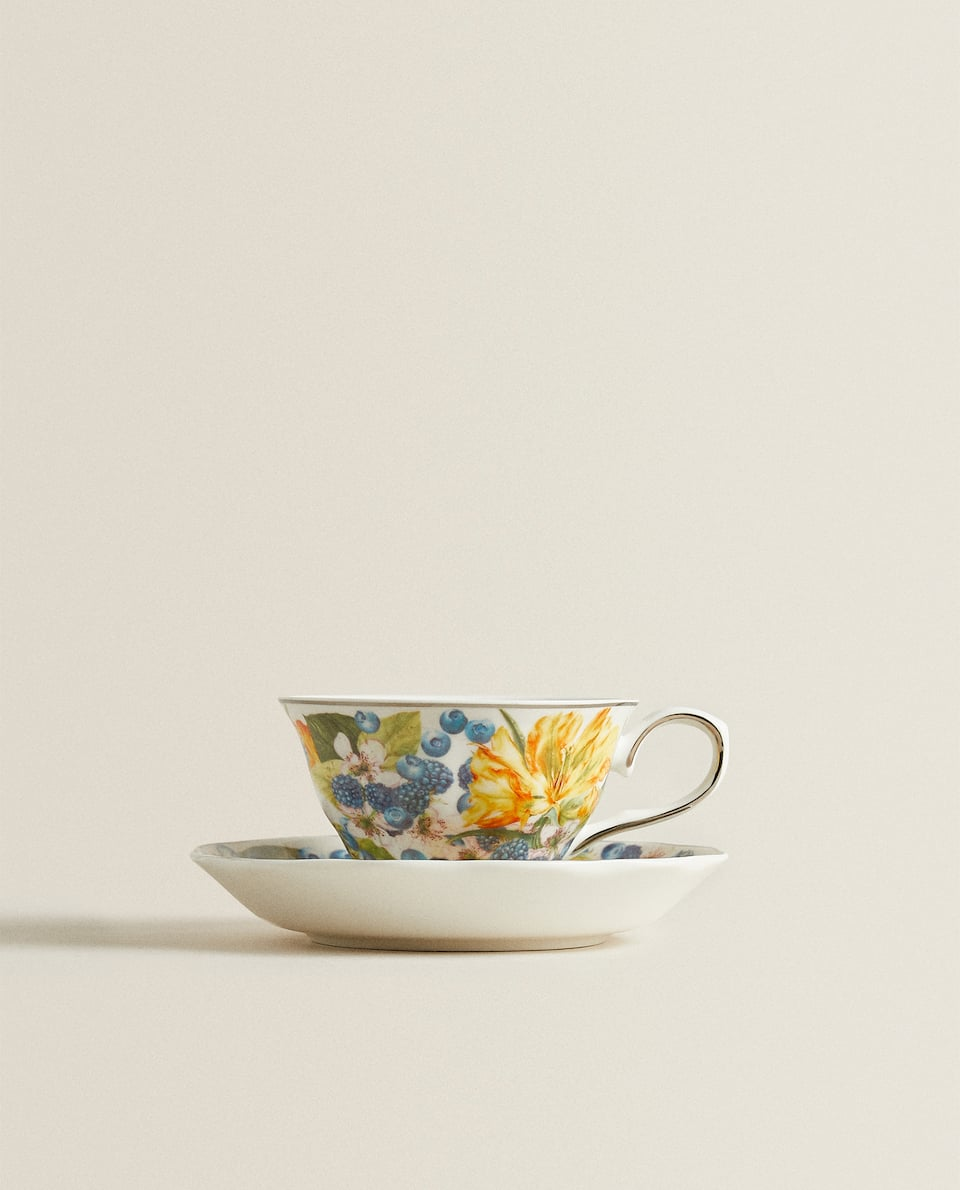 FLOWER MOTIF PORCELAIN TEACUP AND SAUCER