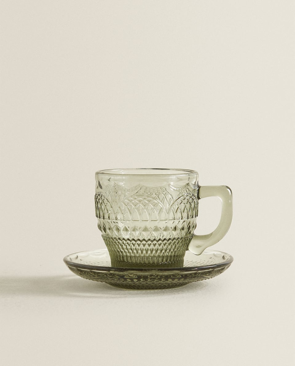 RAISED-DESIGN TEACUP AND SAUCER