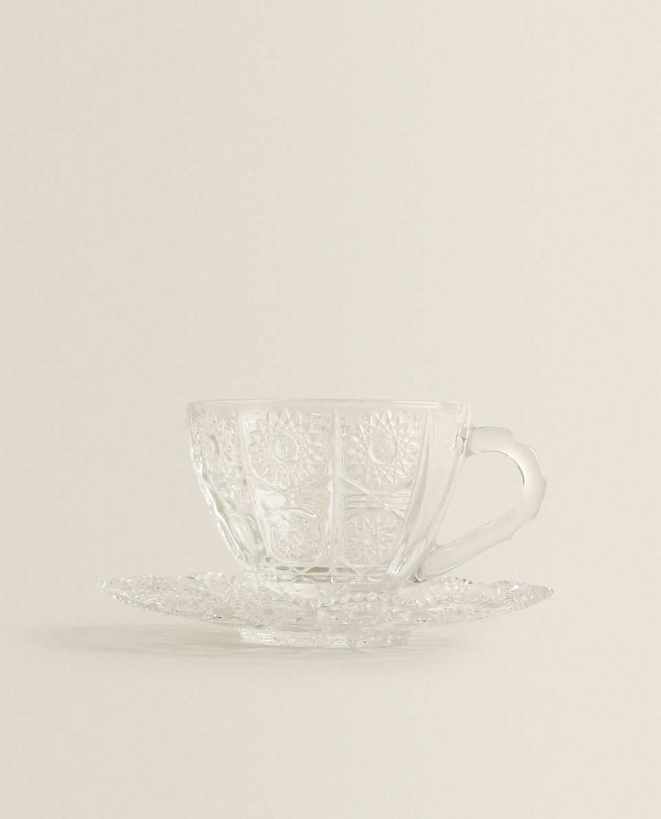 TEACUP AND SAUCER WITH RAISED FLORAL PATTERN