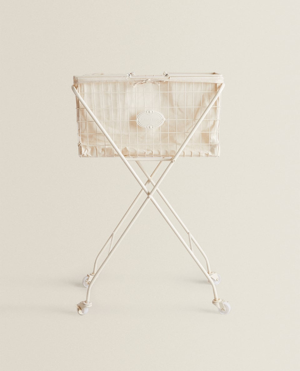 METAL LAUNDRY BASKET ON WHEELS