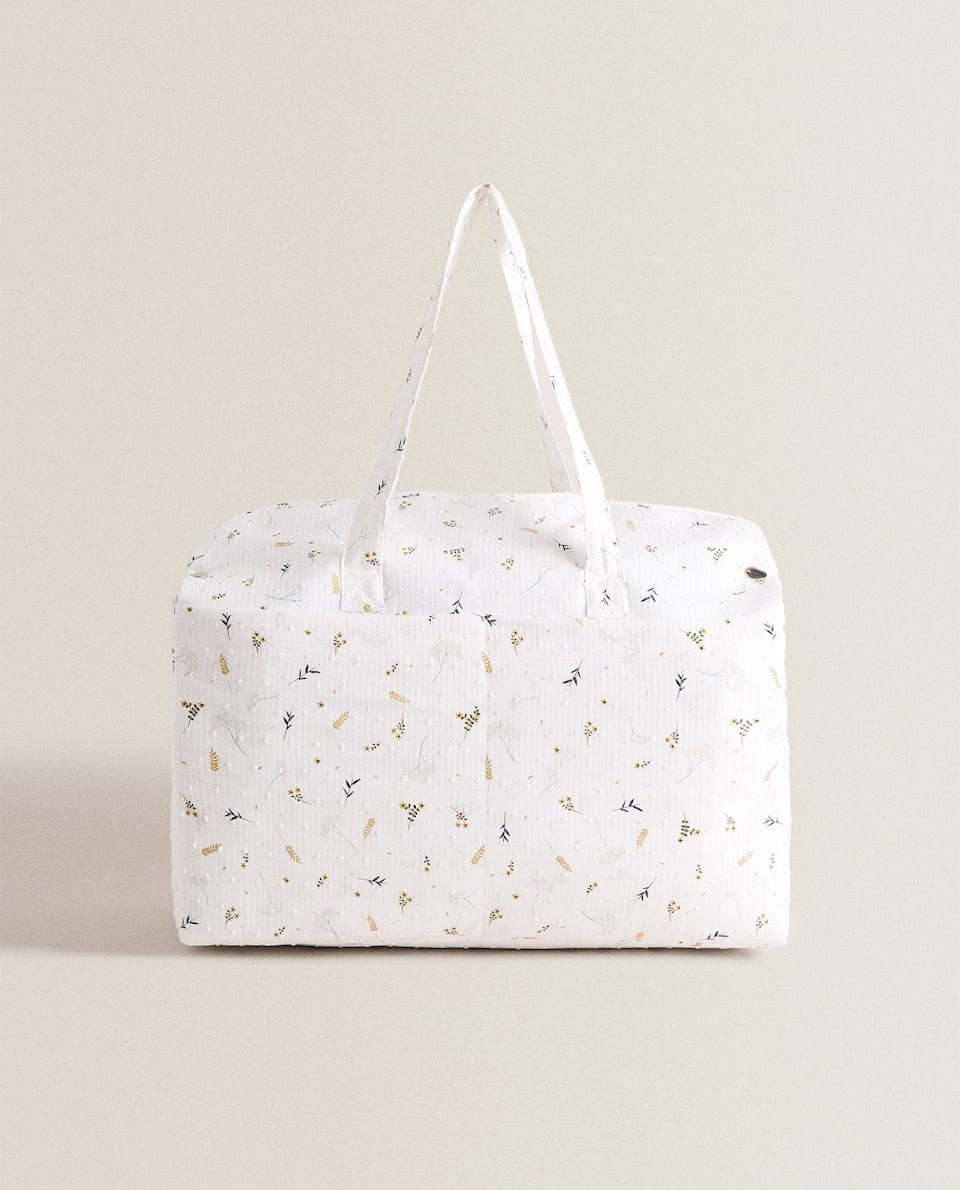 حقيبة الأمومة مزينة بطبعة الأغصان