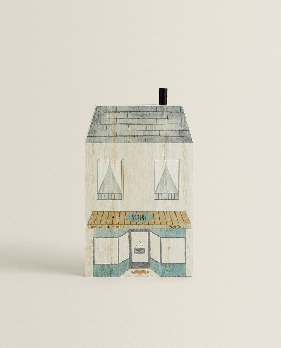 DECORATIVE HOUSE-SHAPED ORNAMENT