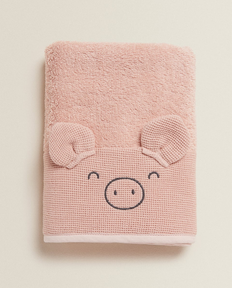 PIG TOWEL WITH WAFFLE-KNIT BORDER