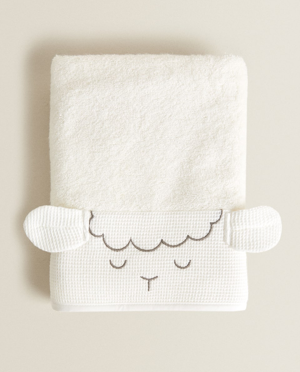 SHEEP TOWEL WITH WAFFLE-KNIT BORDER