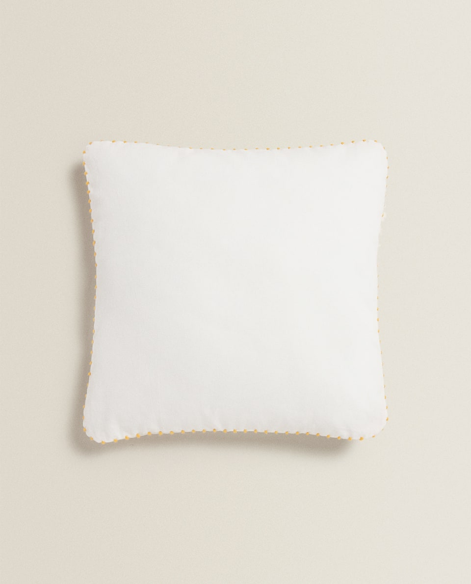 WHITE THROW PILLOW WITH TOPSTITCHING