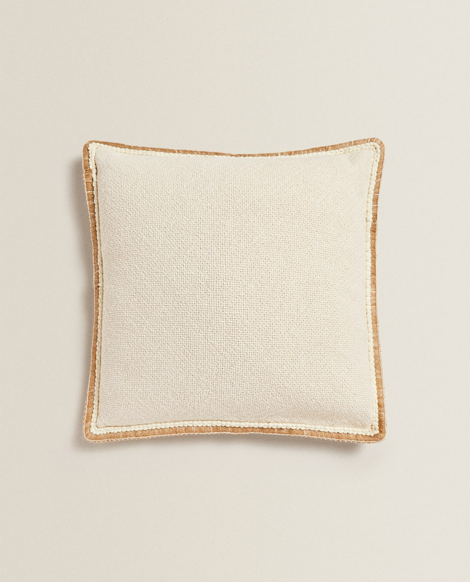 THROW PILLOW WITH STITCHED BORDER