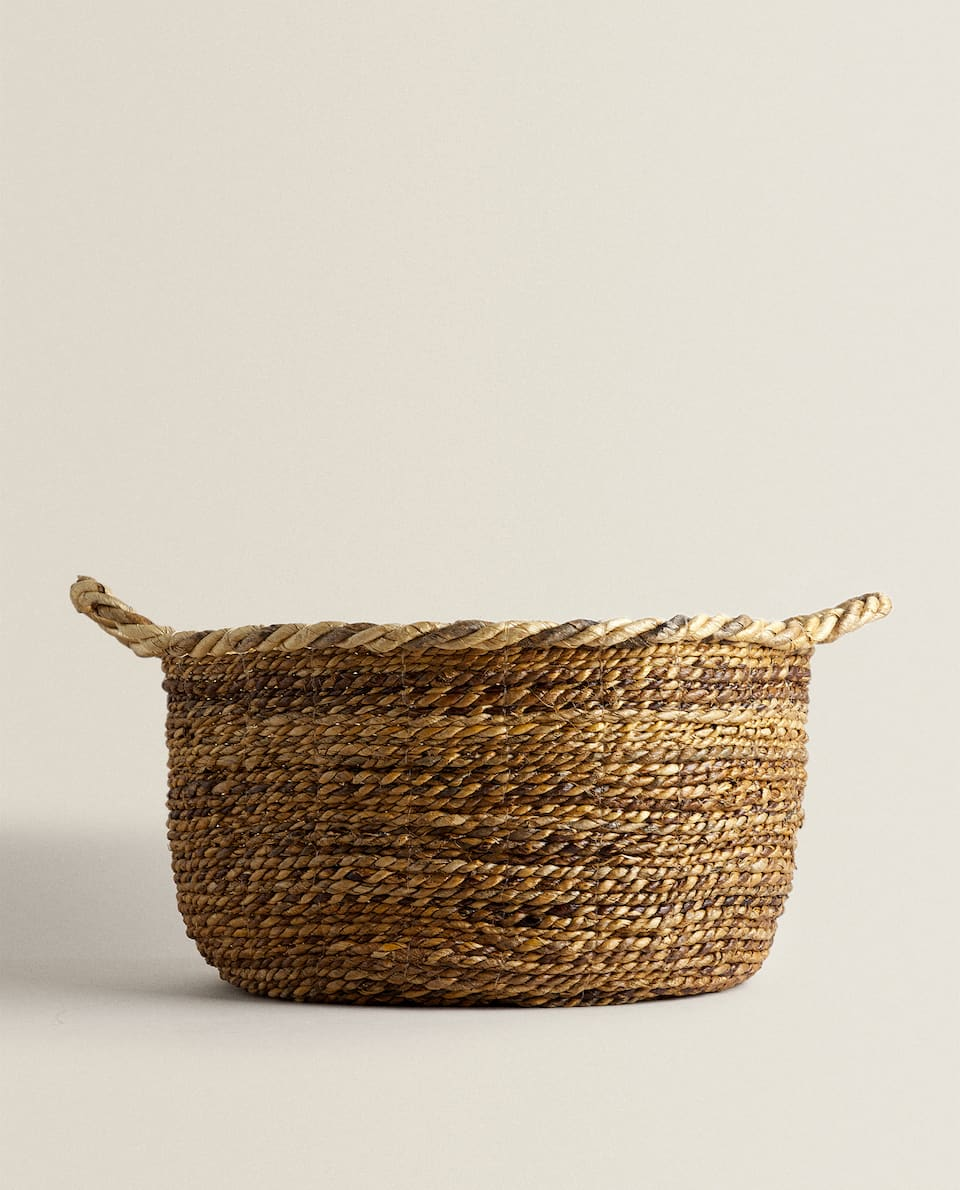 BASKET WITH WOVEN RIM AND HANDLES