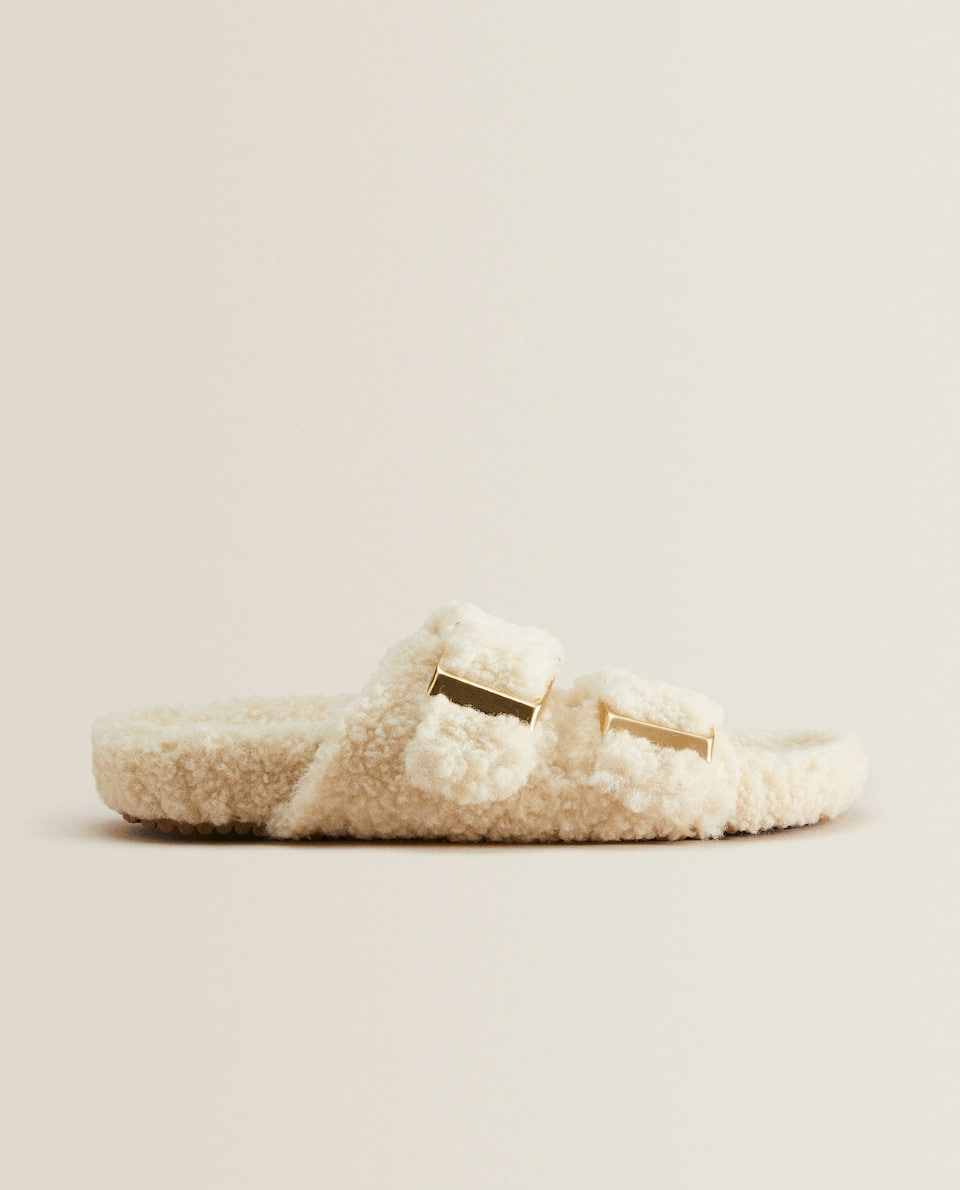 Two-buckled faux fur sandals