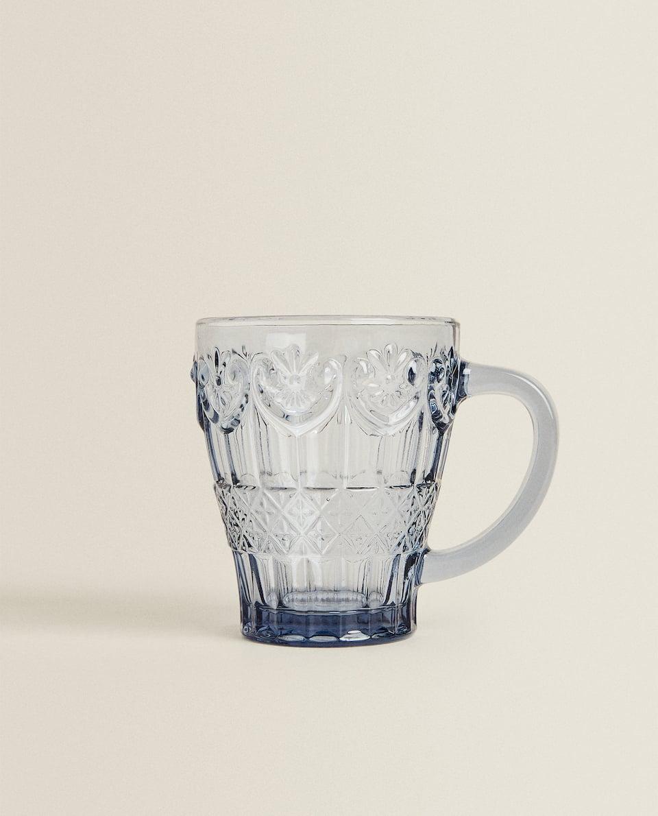 BLUE GLASS MUG WITH RAISED DESIGN